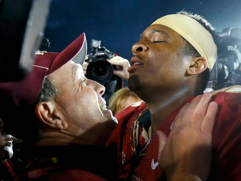 Florida Seminoles head coach Jimbo Fisher (L) celebrates with quarterback Jameis Winston after they defeated the Auburn Tigers to win the BCS Championship football game in Pasadena, Calif., on Jan. 6, 2014.