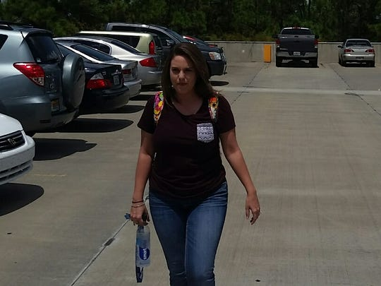 Florida Gulf Coast University student Christine Kellermann, 23, walks to class Sept. 3 after finding a parking spot on the top floor of a garage. She says there is not enough parking spaces on campus.