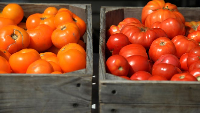 Tomatoes for sale at the Richmond Farmers Market in this file photo.
