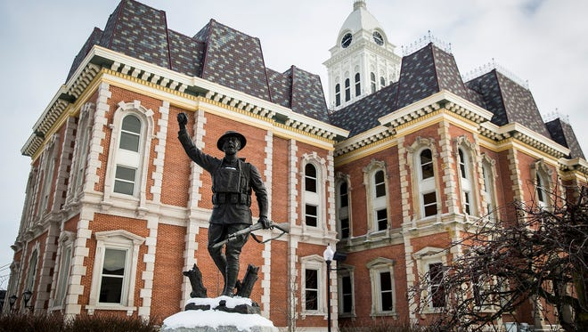 Sculptor E. M. Viquesney's Doughboy statue outside of the Randolph County Courthouse in Winchester Thursday afternoon.