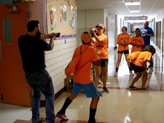 "An armed ""murder suspect"" surprises a group of junior cadets who forgot to clear a stairwell at Booker T. Washington Elementary Wednesday afternoon during a building search exercise of the Wichita Falls Police Department's Junior Police Academy."