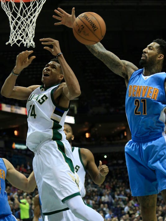 Milwaukee Bucks forward Giannis Antetokounmpo, left, is defended by Denver Nuggets forward Wilson Chandler, right, during the second half of an NBA basketball game Wednesday, March 1, 2017, in Milwaukee. (AP Photo/Darren Hauck)