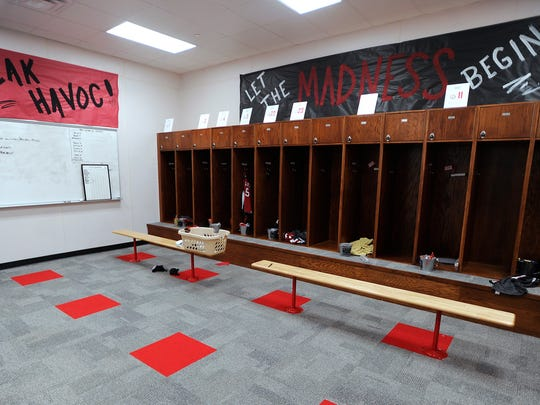 The Colorado High School girls varsity locker room has a carpeted, wooden lockers and a flat-screen television. The varsity boys locker room is identical to the girls locker room.   photo taken 2/10/16