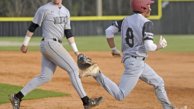 Gadsden City's Daylon Philpot runs out an infield single past Fort Payne's Ben Perry on March 10 during a high school baseball game at Lindsey Field.