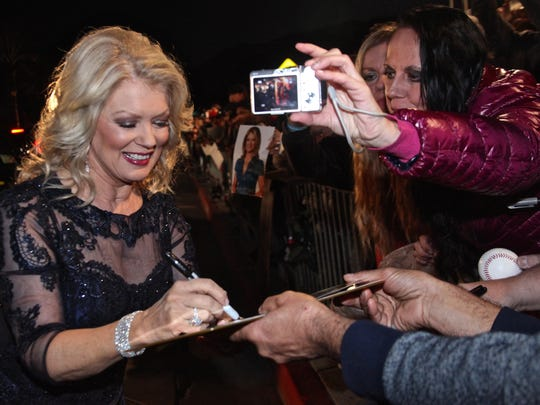 Television personality Mary Hart signs autographs to fans during the 2016 Palm Springs International Film Festival.