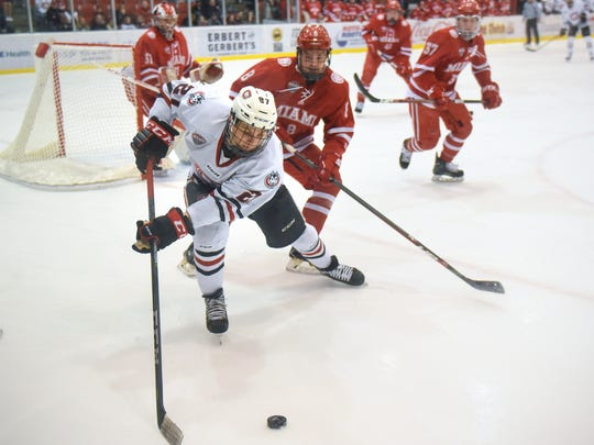 St. Cloud State's Blake Lizotte tries to control the