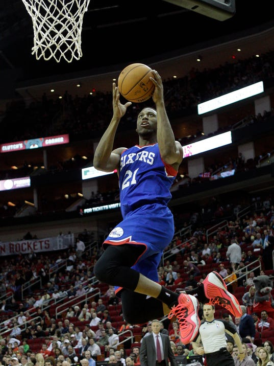 Philadelphia 76ers' Thaddeus Young (21) drives to the basket for a layup against the Houston Rockets during the first half of an NBA basketball game on Thursday, March 27, 2014, in Houston. (AP Photo/Bob Levey)