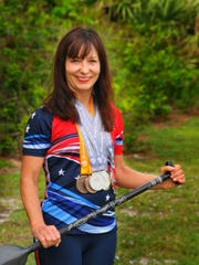 Jacie Stivers shows off her four silver and two bronze medals she won in China at the International Dragon Boat World Championships.