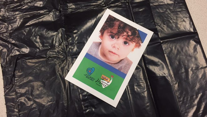 Reporter Jackie Rehwald was given this trash bag and card during a foster care simulation Friday.
