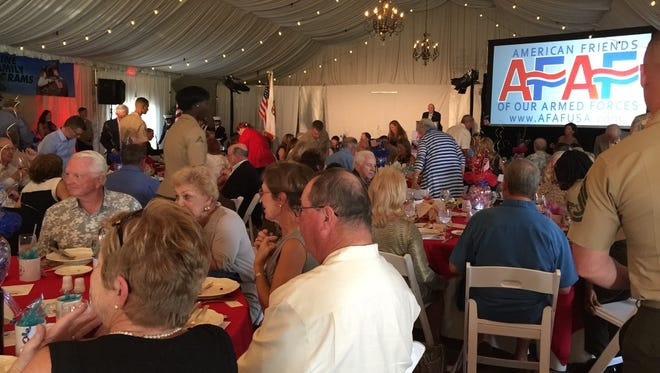 Guests enjoying dinner and conversation at the American Friends of Our Armed Forces.