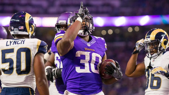 Sep 1, 2016; Minneapolis, MN, USA; Minnesota Vikings running back C.J. Ham (30) celebrates his touchdown in the fourth quarter against the Los Angeles Rams at U.S. Bank Stadium. the Minnesota Vikings beat the Los Angeles Rams 27-25. Mandatory Credit: Brad Rempel-USA TODAY Sports
