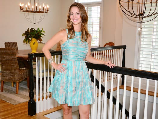 Kelly Gibson models her Gianni Bini dress, Dillard's; and Dolce Vita shoes, earrings and necklace, Aldo.For more stories and photos, see the July