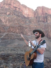 Drake White talks with those who joined him for a private concert of VIPs and friends after flying them to the bottom of the Grand Canyon.