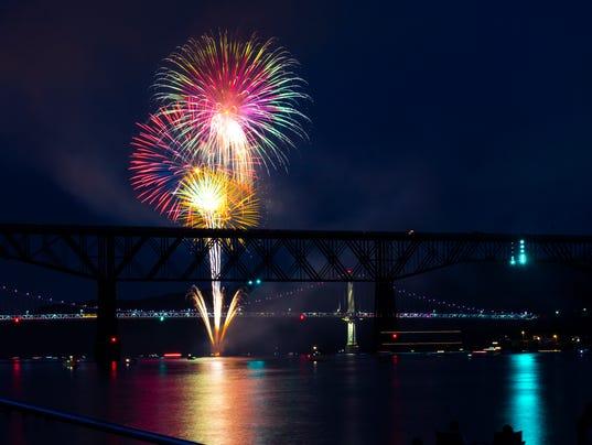 Fireworks illuminate the Walkway Over the Hudson