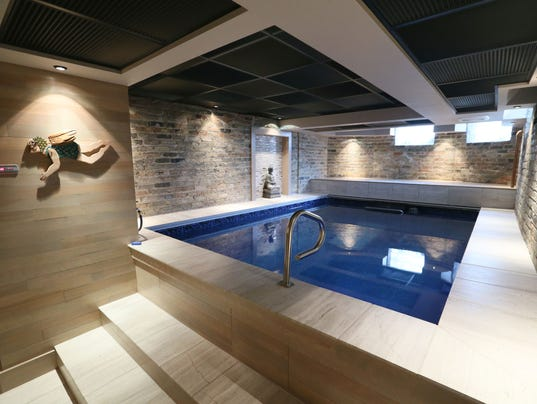 A Victorian farmhouse with a pool in the basement