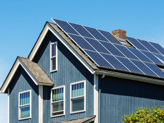 Traditional American Home with Modern Solar Panels on Roof
