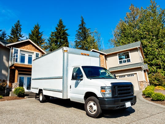 Plain White Moving Truck in Driveway