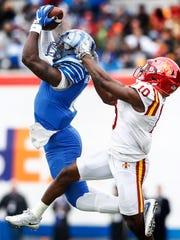 Memphis running back Patrick Taylor Jr., (left) grabs