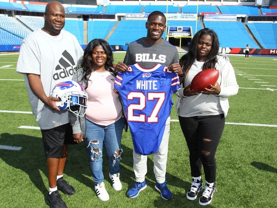 Buffalo Bills; first-round NFL football draft pick Tre'Davious White, second from right, poses with, from left to right, his father, David White, mother, LaShawnita Ruffins, and sister, La'Daijah White, following a media conference at New Era Field.