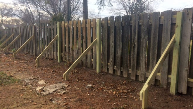 Some of the damaged fence panels that were repaired with new posts and supports by volunteers Nov. 12 at the home of Allouez resident Valerie Jerabek.