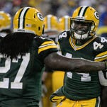 Green Bay Packers running back James Starks (44) celebrates his fourth-quarter touchdown with Eddie Lacy in a win over the Dallas Cowboys on Sunday at Lambeau Field.
