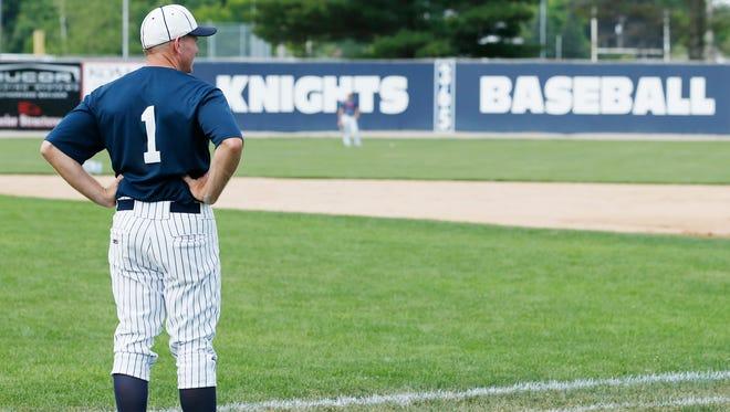 Central Catholic baseball coach Tim Bordenet overlooks a practice at Leming Field.