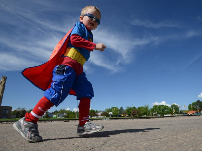 A boy dressed as Superman runs at the Houska Houska 5K run Monday May 26, 2014. Proceeds from the race to to the PVH Cancer Center and for bone marrow national registry.