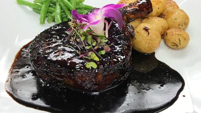 Balsamic glazed pork chop from Punto Rosso in Montclair.