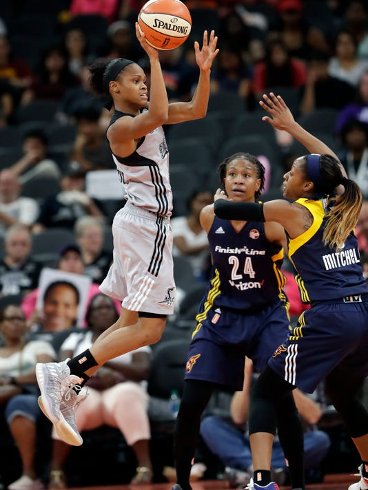San Antonio Stars guard Moriah Jefferson, left, passes the ball over Indiana Fever forward Tamika Catchings (24) and guard Tiffany Mitchell during a WNBA basketball game, Tuesday, Sept. 6, 2016, in San Antonio. (AP Photo/Eric Gay)