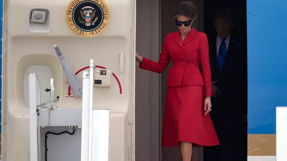 Melania Trump nails diplomatic style with red Dior skirt suit in Paris 184f8190a