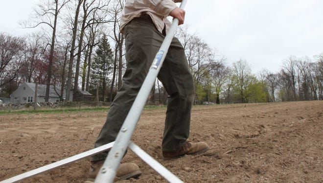 Farm manager Shane Hardy of Stony Point works at Rockland Farm Alliance's Cropsey Community Farm in New City  April 18.