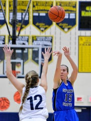 Spring Grove's Lexi Hoffman (right) takes a shot in a game last season. Hoffman is currently second in scoring on the Rockets, who are off to a 6-0 start.