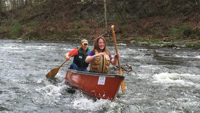 Destinee Hauptman of Red Hook and Alex Beaulieu of Elmira travel down the Wappinger Creek during the Wappingers Creek Water Derby Saturday, April 23, 2016.