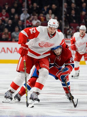 Jonathan Ericsson, left, of the Detroit Red Wings skates against Phillip Danault of the Montreal Canadiens on March 29, 2016, in Montreal.