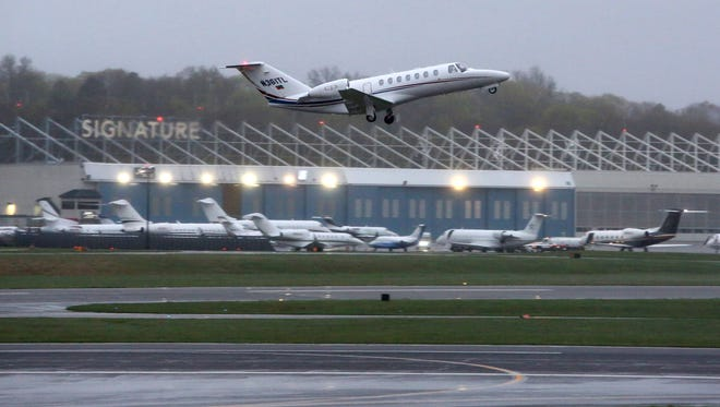 A jet takes off at the Westchester County Airport in White Plains around 6:25 a.m., April 26, 2017.