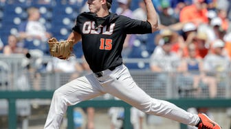 Oregon State pitcher Luke Heimlich (15) throws against North Carolina in the first inning of an NCAA College World Series baseball game in Omaha, Neb., Saturday, June 16, 2018. (AP Photo/Nati Harnik)