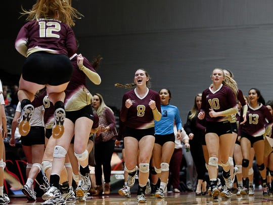 Tuloso-Midway players celebrate after winning the first set against Amarillo High in a Class 5A volleyball state semifinal at the Curtis Culwell Center in Garland, Texas on Friday.