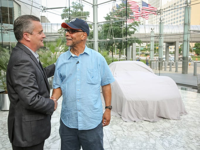 General Motors Communications Director Terry Rhadigan (left) reunites George Talley with his 1979 Chevrolet Corvette Tuesday at GM headquarters 33 years after it was stolen in Detroit. Talley received a call from AAA informing him his car turned up in Hattiesburg, Mississippi.