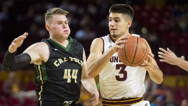 ASU freshman guard Sam Cunliffe (3) looks to pass as Cal Poly senior forward Zach Gordon (44) defends in the second half at Wells Fargo Arena in Tempe on Sunday, Nov. 13, 2016.