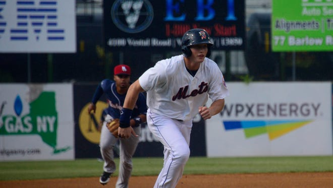 Binghamton Mets outfielder Brandon Nimmo runs from third base towards home plate during a game at NYSEG Stadium during the 2014 season.