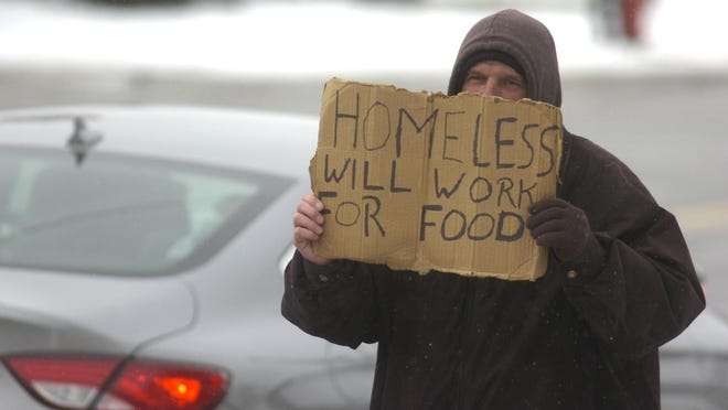A panhandler at 14 Mile and Woodward said he's a carpenter who lost his job in September. He is willing to work for food.