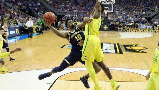 Michigan guard Derrick Walton Jr. shoots against Oregon's Jordan Bell in the second half of U-M's 69-68 loss in the 2017 NCAA tournament Midwest Regional at Sprint Center on Thursday, March 23 in Kansas City.