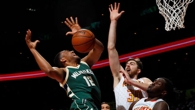 Bucks forward Jabari Parker has the ball stripped by Atlanta's  Taurean Prince in Milwaukee's 107-100 loss to the Hawks on Wednesday night at Philips Arena in Atlanta.