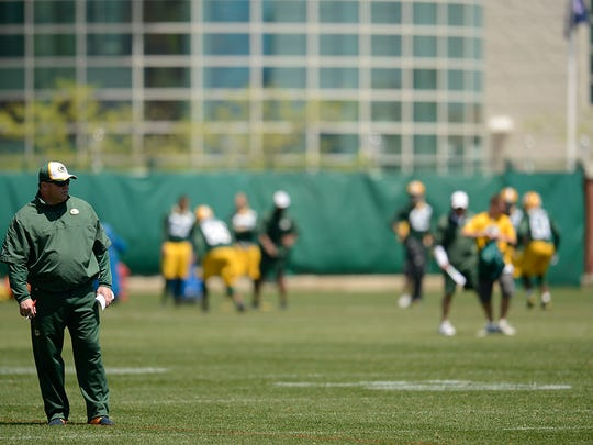 Green Bay Packers head coach Mike McCarthy looks on during OTAs at Ray Nitschke Field.