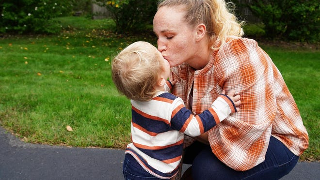 Schuyler Cumback, 32, gives her son Tyrson Cumback a kiss, after being reunited again. The Marsh family of Stratham fostered Tyrson through the COVID-19 quarantine months until recently.