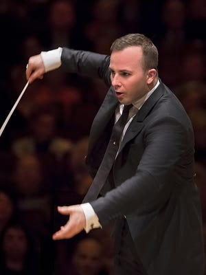 Yannick Nézet-Séguin conducts the Philadelphia Orchestra at Carnegie Hall. Thursday, it was announced Nézet-Séguin would stay with the orchestra until 2026.