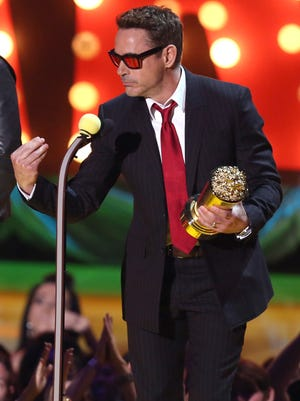 Robert Downey Jr. accepts the generation award at the MTV Movie Awards at the Nokia Theatre on Sunday, April 12, 2015, in Los Angeles. (Photo by Matt Sayles/Invision/AP) ORG XMIT: CACJ177