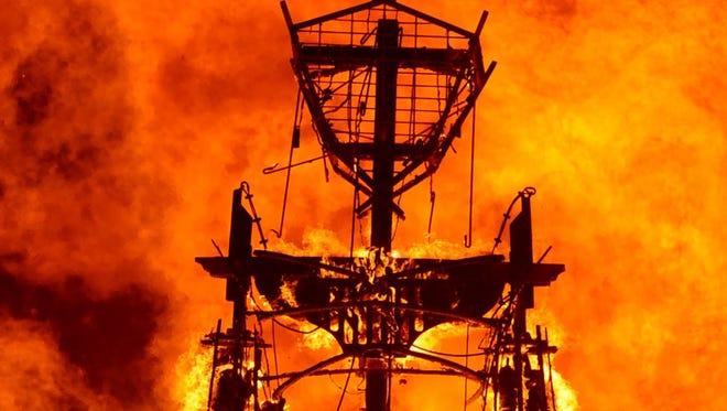 "The ""Man"" burns on the Black Rock Desert at Burning Man in 2013."