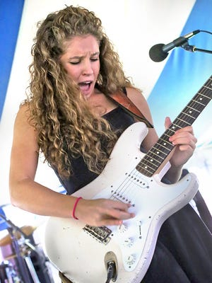 Sadie Johnson performs with the Sad Sam Blues Jam at the Penrod Arts Fair.