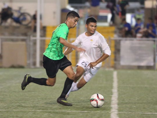 ASC Trust Islanders' Devan Mendiola sprints with the ball through the midfield against the Tigers in a U18 division match of the 2017 Aloha Maid Minetgot Cup Elite Youth League at the Guam Football Association National Training Center played Aug. 24.